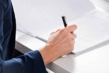 Cropped view of team leader signing document on desk stock vector