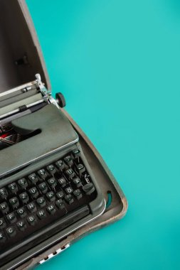 Retro typewriter in open case on turquoise background stock vector