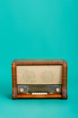 Wooden radio on turquoise background with copy space stock vector