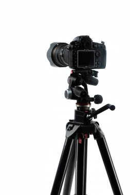 Photo camera on tripod isolated on white stock vector