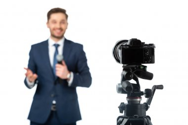 Selective focus of digital camera near news anchor on blurred background isolated on white stock vector