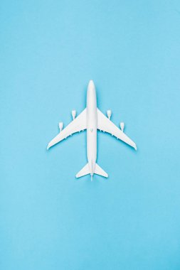 Top view of white plane model on blue background stock vector