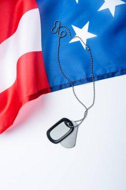 Blank metallic badge on chain near american flag on white stock vector