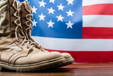 Army boots near american flag on blurred background stock vector