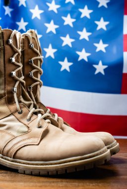 Military boots near american flag on blurred background stock vector