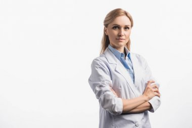 Confident nurse in white coat standing with crossed arms isolated on white stock vector