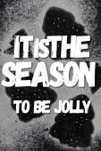 Top view of pine silhouettes covered with sugar powder with it is the season to be jolly lettering