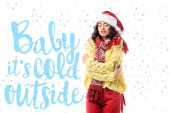 young freezing woman in santa hat and scarf standing near baby its cold outside lettering on white