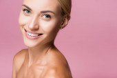 smiling beautiful blonde woman with perfect skin isolated on pink