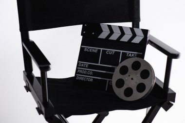 Filmmaker chair, clapperboard and film bobbin on white, cinema concept stock vector