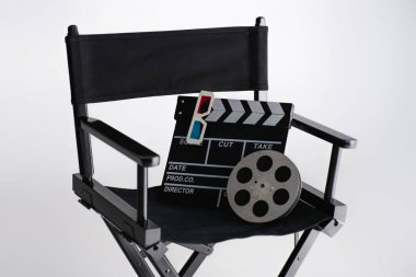 Clapperboard, 3d glasses and film coil on filmmaker chair on white, cinema concept stock vector