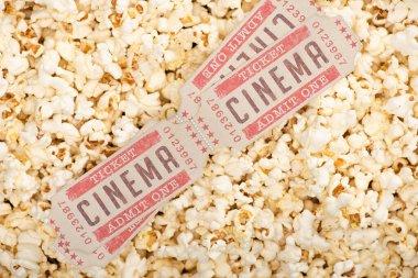 Top view of cinema tickets on airy crispy popcorn stock vector