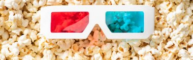 Top view of 3d glasses on scattered popcorn, banner, cinema concept stock vector