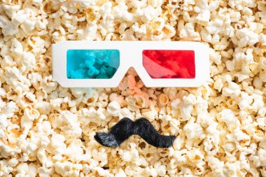 Top view of 3d glasses and artificial mustache on scattered popcorn, cinema concept stock vector