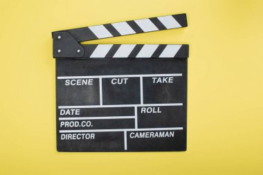 Top view of clapperboard on yellow, cinema concept stock vector