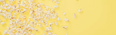 Top view of salty tasty popcorn on yellow, banner, cinema concept stock vector