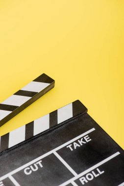 Close up view of clapperboard on yellow, cinema concept stock vector