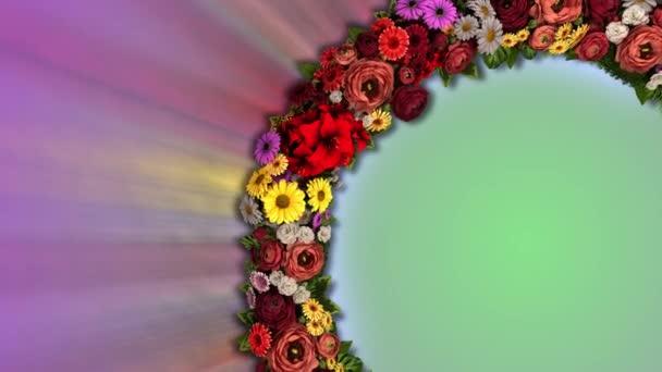 Animace vířícího kruhu květin vyzařujících pestrobarevné paprsky. Video smyčka