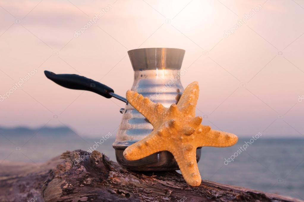 Coffee maker with freshly brewed coffee and starfish