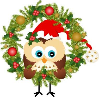 Owl sitting in a Christmas wreath