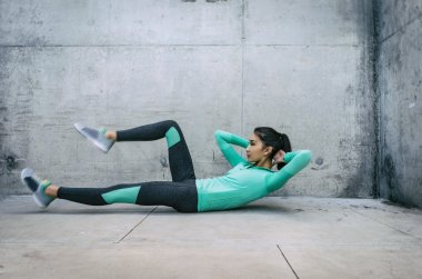 Woman performing core crunch