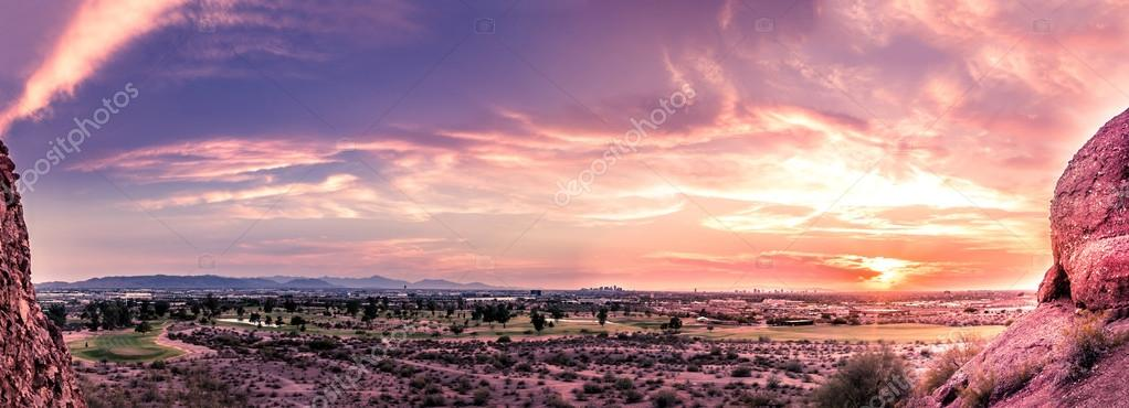Panorama of sunset over late evening red sky over Phoenix,Arizona.  Papago Park buttes in foreground.