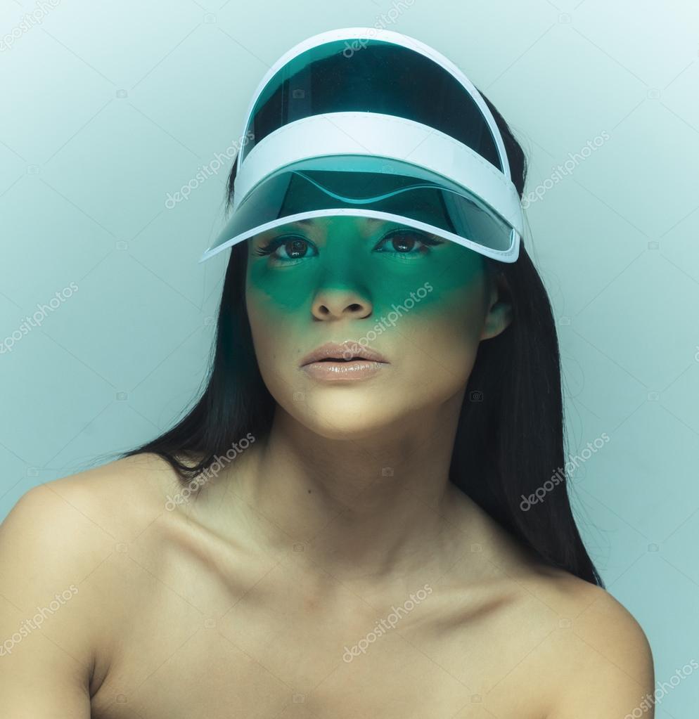 e844bdee Beautiful woman wearing sun visor — Stock Photo © paulmhill #52011585