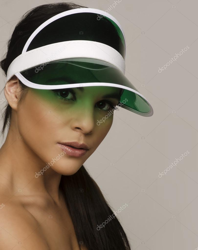 dee2f07c Beautiful woman wearing sun visor — Stock Photo © paulmhill #52011615
