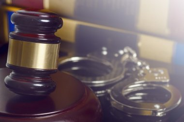 Gavel and handcuffs law order concept image