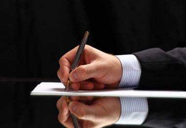 Man signing document