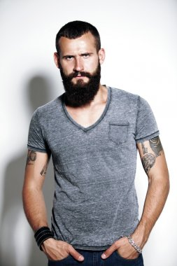 Bearded man wearing gray t-shirt