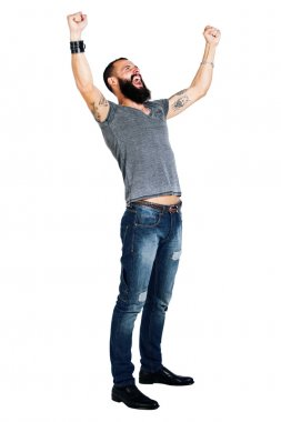 Tattooed bearded man with arms raised in succes