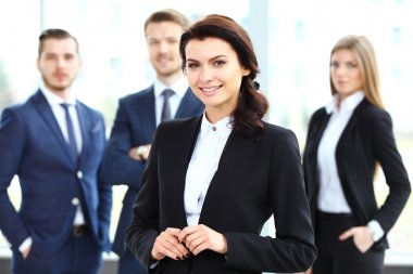 Woman on the background of business people