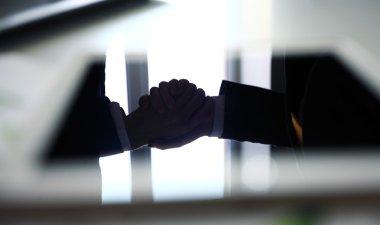 businessmen handshake close up