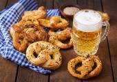 Salted soft pretzels in a bowl and beer