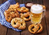 Fotografie Salted soft pretzels in a bowl and beer