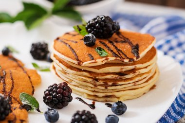 Pancakes with blackberries and chocolate