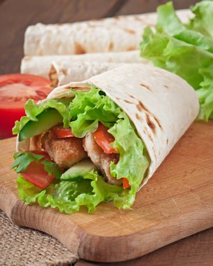 Fresh tortilla wraps with chicken nuggets and vegetables
