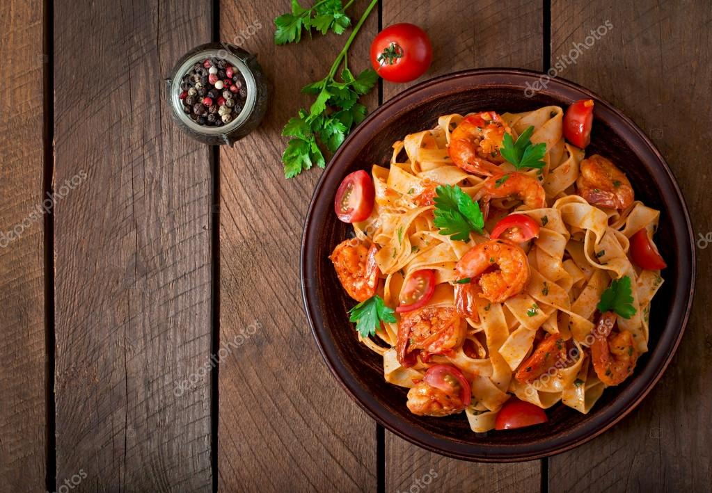 Fettuccine pasta with shrimps, tomatoes and herbs.