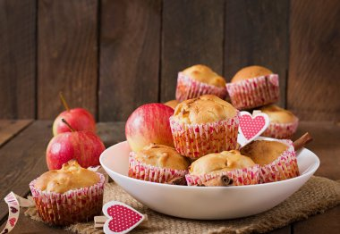 muffins with apples , cinnamon and hearts decorations
