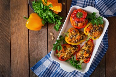 Stuffed peppers with rice, beans and pumpkin