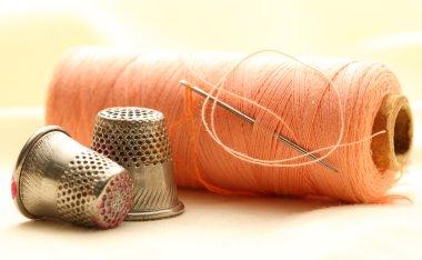 Thread bobbins and metal sewing thimbles stock vector
