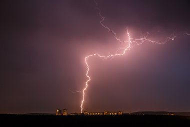 Night thunder lightning over city