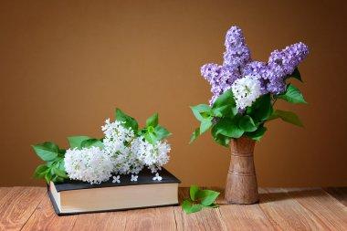 Purple, white lilacs in a vase