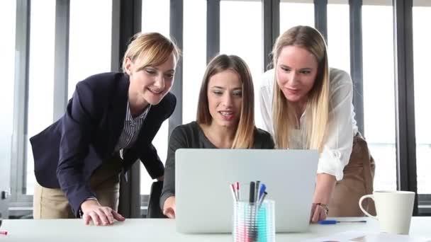 businesswomen with laptop in office