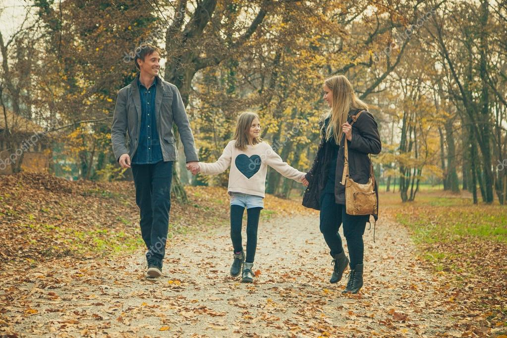 Family walk in a park