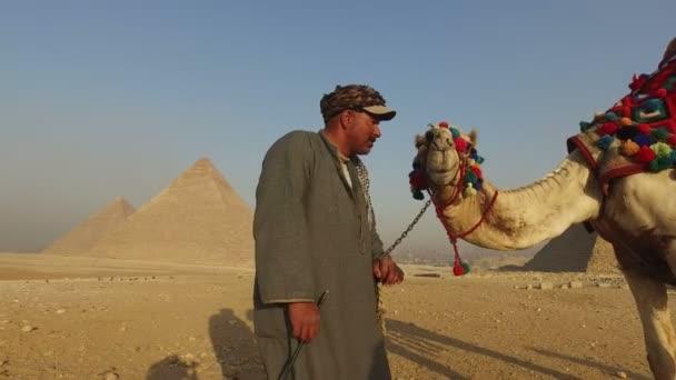 man kissing his camel
