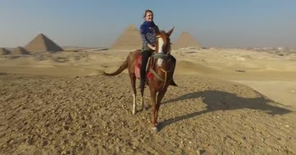 woman on horseback at Giza pyramids