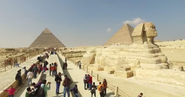 Tourists visiting Giza pyramids