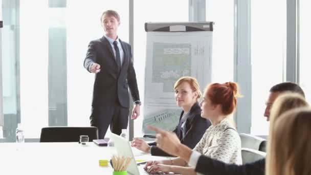 Business people talking during presentation